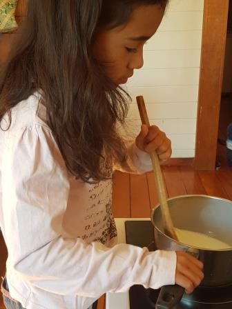 mariana is cooking a dish